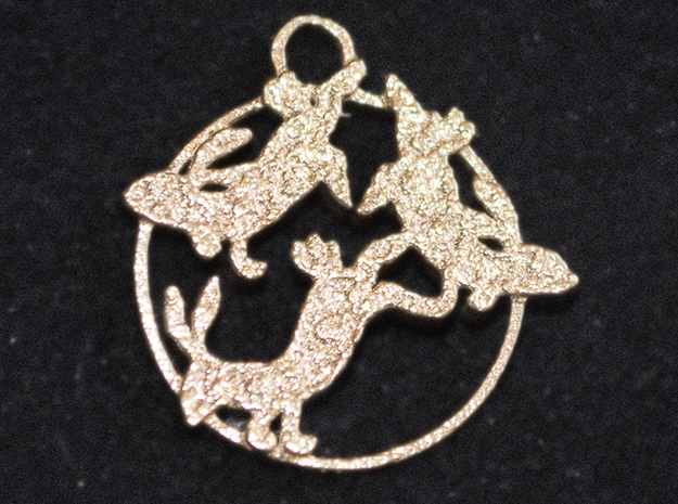 Raw bronze pendant in shape of three hares.