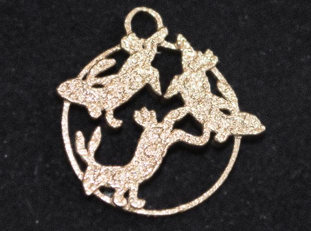 Raw bronze pendant in shape of three hares.